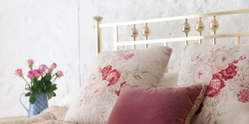 close up of rosie single brass and nickel bed