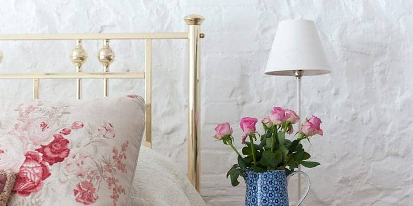 close up of rosie brass and nickel bed