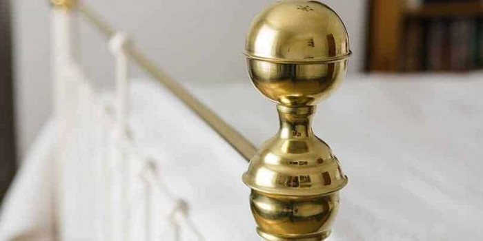 iron and brass bed finial