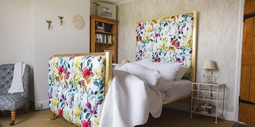 anne iron and upholstered bed in designers guild fuchia rose couture