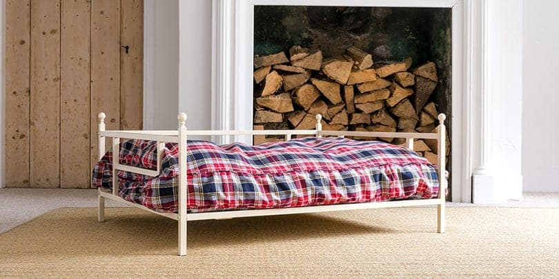 iron dog bed with tartan cushion