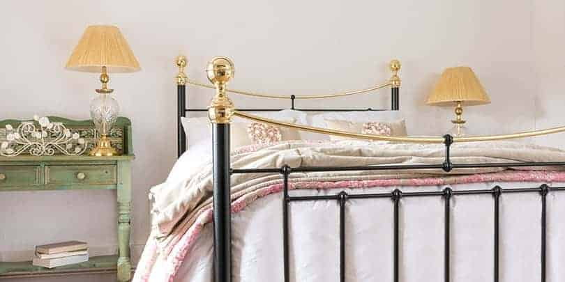 side close up of helena iron and brass bed