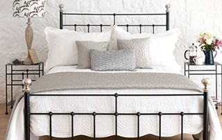 close up of black iron bed