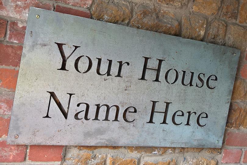 bespoke iron house sign
