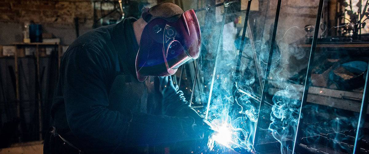 man doing bespoke iron fabrication