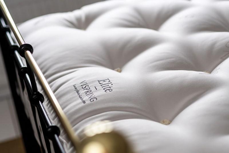 vispring elite tufts close up